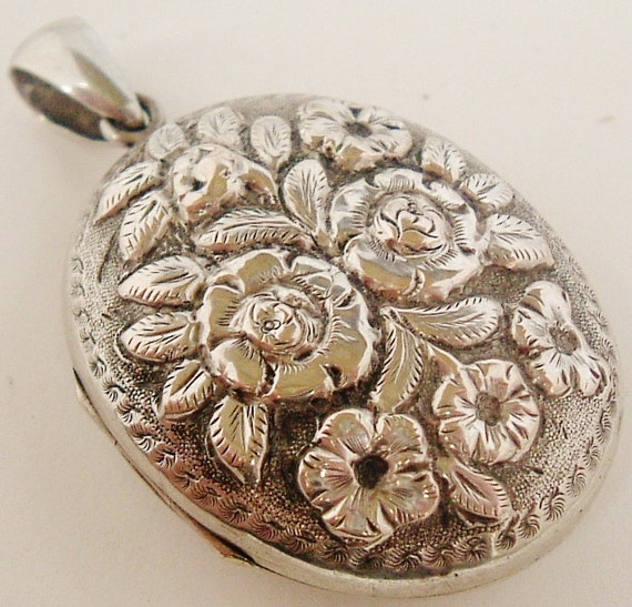Antique French art nouveau silver plate locket embossed with roses