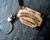 Gothic Halloween Necklace Ouija Board Cherub Charm Monocle Steampunk Victorian Halloween Jewelry by pennyfarthingdesigns on Etsy