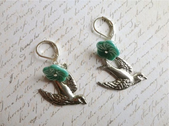 Tailwinds swooping silver tone sparrow and teal czech flower earrings