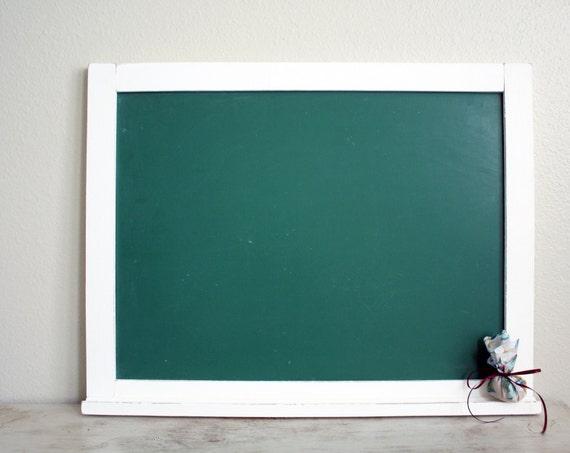 Vintage school chalkboard with shelf