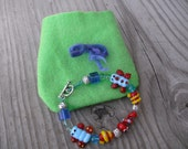 Snakes and Butterflies Oh My  Lampwork bead Children's Bracelet With Gift Pouch