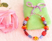 Children's Lamp work beads snakes and flowers
