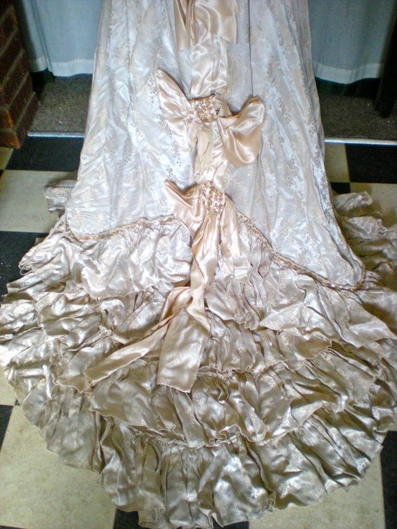 Edwardian style wedding gown with train, ruffles, bows and sequins