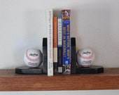 Bookends with a baseball or hockey theme. Multiple colors are available.