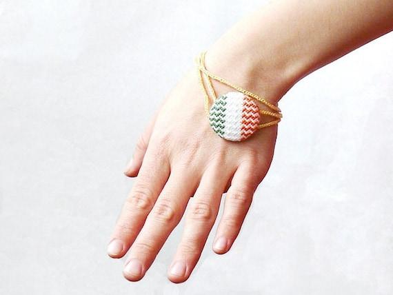 Cross stitch infinity bracelet with Irish flag