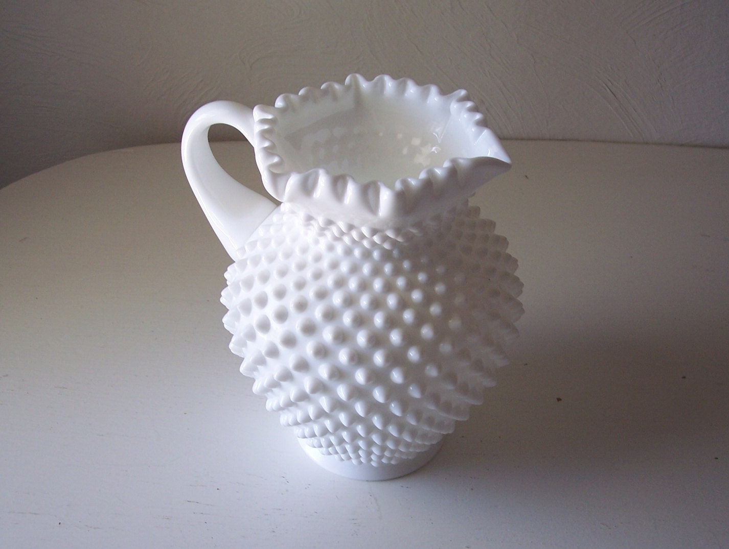 vintage white milk glass hobnail pitcher with fluted edge