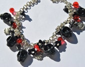 Bracelet with Black Skulls, flowers,glass beads and owls charms