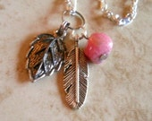 Rhodocrosite gemstone necklace with feather and leaf charms silver plated 18 inch chain Item 188