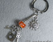 Orange sunshine with lock and key charms silver key chain keyring