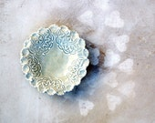 Reserved for S. Ricci Tea dish imprinted with lace and detailed