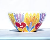 Bright bowl in yellow, orange, pinks and purples