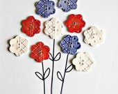Red, white and blue flower imprinted buttons