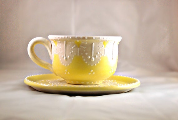 Tea cup and saucer  hand painted in yellow shabby chic style