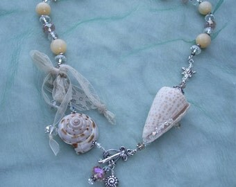 OCEAN BREEZE, a Sea Shell Necklace,  created with vintage beads,crystals ,sterling silver, and a found shell