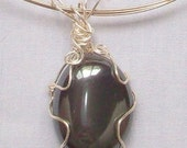 Handmade Bold Wire Wrapped Hematite pendant on Silver plated choker with Sterling Silver beads on choker ends.