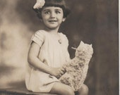 Vintage RPPC Beautiful Happy Little Girl 1931 cat doll and hairbow