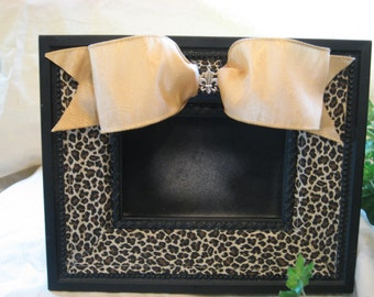 Leopard print frame with fleur de lis charm on a beautiful gold bow