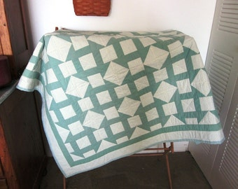 Green and off white baby quilt