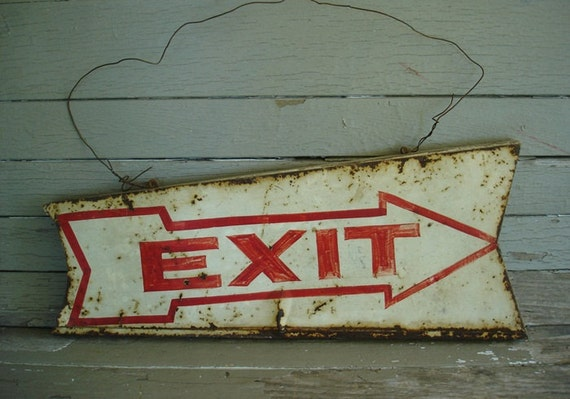 rusty and crusty tin EXIT sign