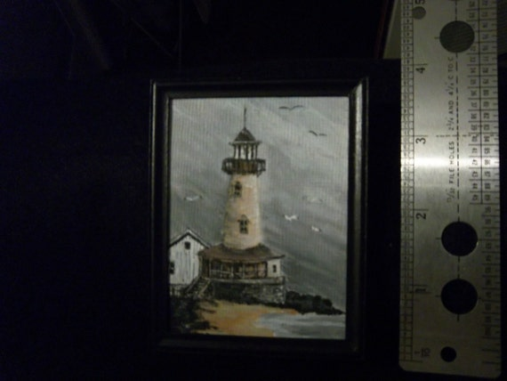 Lighthouse and Stormy Skies