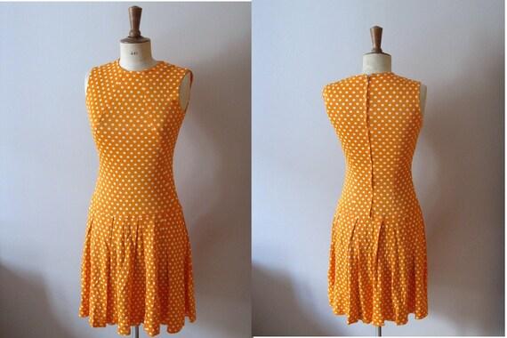 vintage 1960s orange polka dot pleated dress