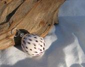 purple and white ceramic pendant
