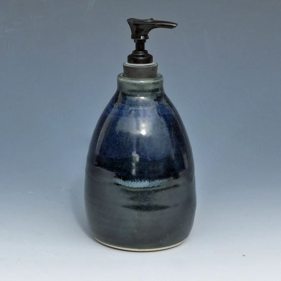 Black pottery soap dispenser with blue accents