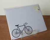 white writing paper: bicycle