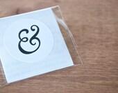 white envelope seals: ampersand