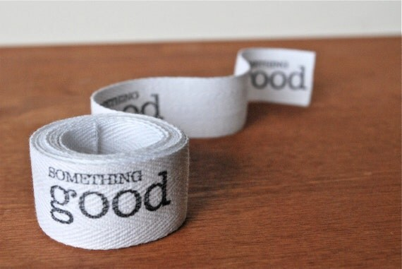 white cotton twill tape: black something good small caps text
