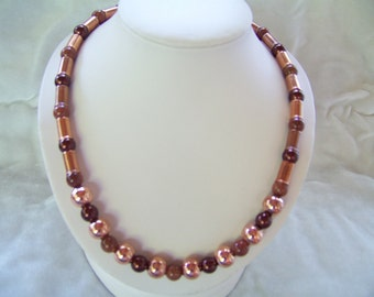 Sleek, earthy copper and brown necklace, bracelet and earrings