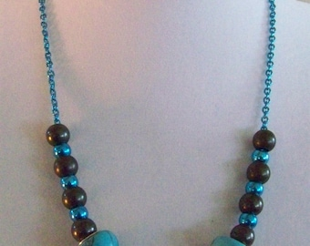 Untraditional turquoise.  Turquoise with midnight gray necklace w earrings