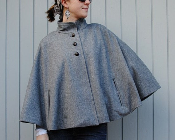 Fully lined grey wool capelet with pockets.