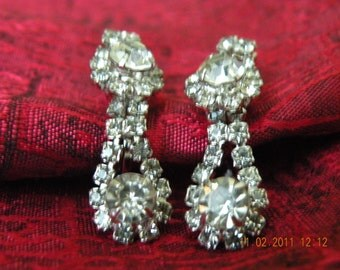 Double drop, dangle clear rhinestones screw back earrings.
