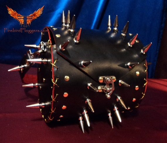 Black and red spiked handbag