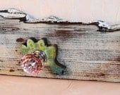 Antique barn wood wall hanger and organizer with owl and frog accented knobs for hanging