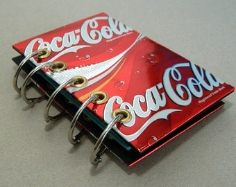 Refillable notebook covered with Coca Cola can