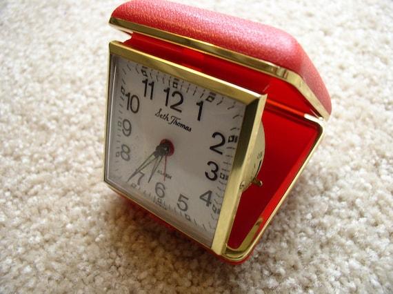 Vintage red Seth Thomas wind up travel clock-alarm-works