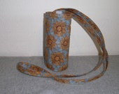 Insulated Water Bottle Carrier - Suns on Light Blue Background