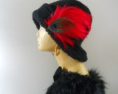 Elegant hat, crochet made with red feathers.