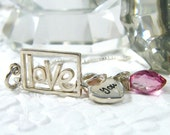 love you necklace hand stamped sterling silver tag with pink topaz marquise