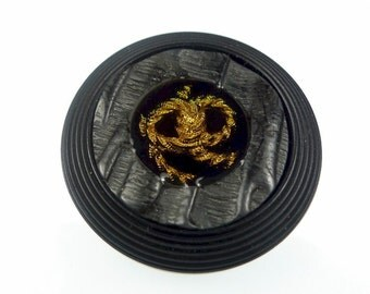 Buttons, black resin with a golden rope 1pc