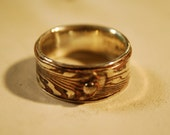 Fine Silver/Copper mokume gane ring with sterling liner woodgrain with sterling rivet.