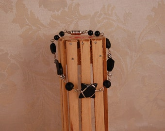 Jet Black Beads Wrapped in Silver Bracelet