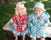 Litttle girl's red-and-white polka dot raincoat with turquoise trim, BPA-free, original design, size 4