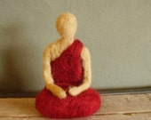 Buddhist monk in red robes, a needle-felted wool sculpture