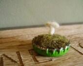 Felted wool mushroom in a bottlecap, green