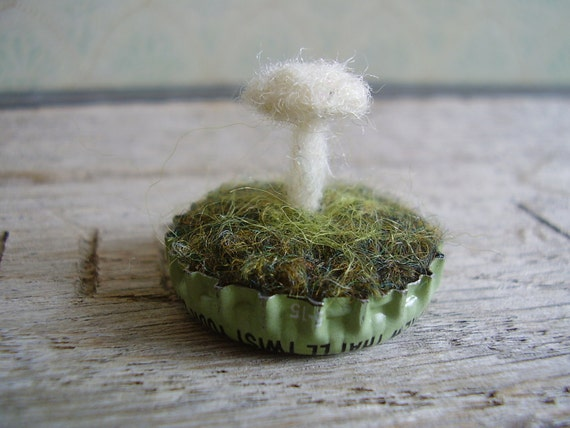 Felted white mushroom in a pastel green bottlecap, a tiny tiny felted wool garden