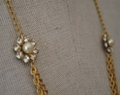 Long rhinestone and glass pearl necklace