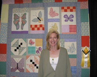 Butterfly hand-quilted hand-appliqued quilt in bright pastels